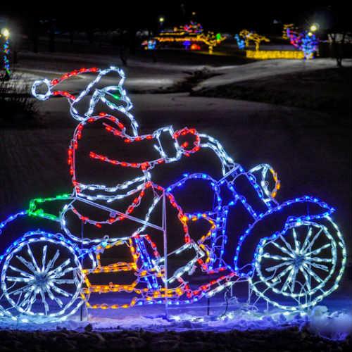 santa on a neon bike